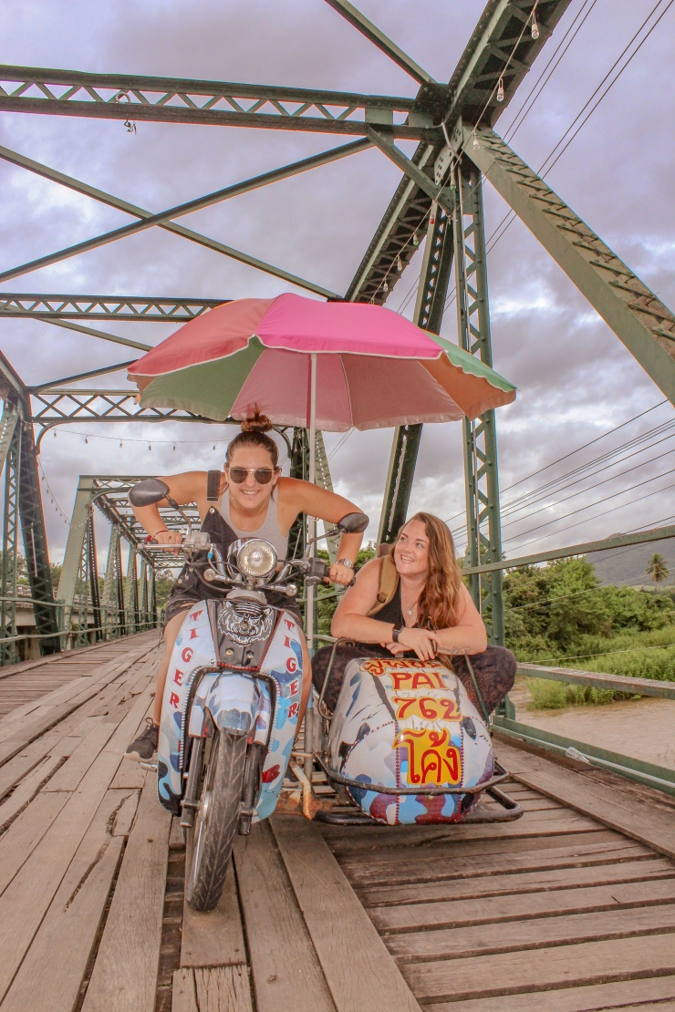 Pai Memorial Bridge, moped and sidecar with rainbow umbrella