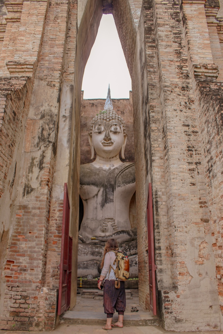 Ells admiring just one of the magnificent Buddhas - Wat Si Chum, part of the Sukhothai Heritage Park in Northern Thailand
