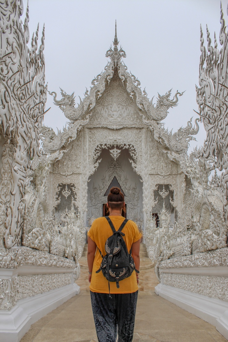 Steff walking across the bridge to enter The White Temple (Wat Rong Khun) in Chiang Rai, Northern Thailand