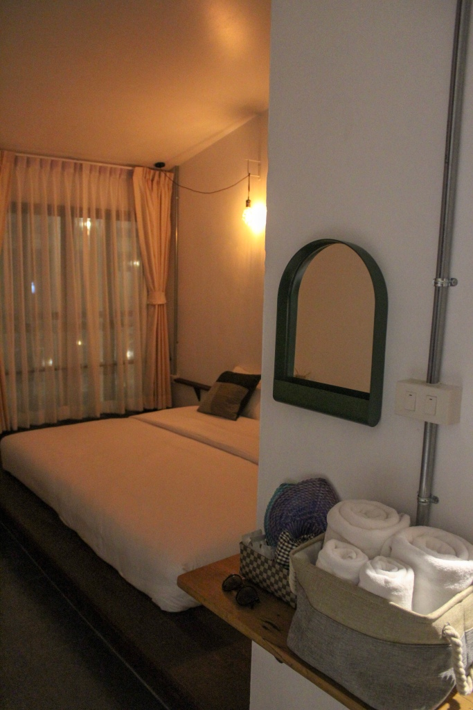 King size bed in room at Krodyle Mindfulness House in Ayutthaya, Thailand